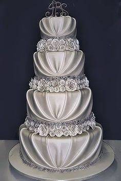 Silver wedding cake with draping