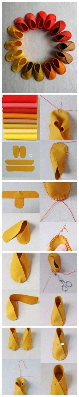 材料:不织布 剪刀 胶水 针线  将不织布剪成如上图所示的一共四个部分  将其中的一个带子这样子折起来,用针线缝合边上 注意这边的缝制针法以及折的方法 其实就是很简单的把鞋底以及鞋面交叉着缝制在一起  比较需要注意的就是缝制方法了   鞋边缝制好之后,用这样子的十字针法在鞋子上面缝上两针就好啦