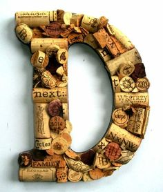 Corks glued to a cutout letter (you can buy at craft stores and attach with a hot glue gun or strong glue)