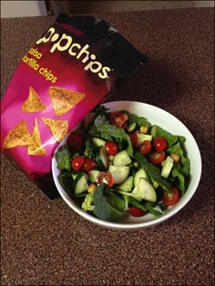 salad with chickpeas, tomatoes, and cucumber & salsa tortilla popchips