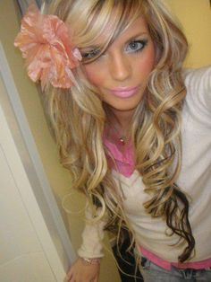 long wavy hair with flower, as a girl