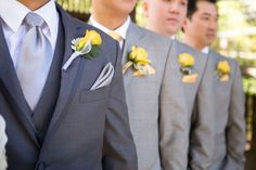 Yellow boutonnieres and grey groomsmen suits // OneWed