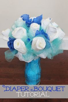 Follow these easy step-by-step instructions to make a diaper bouquet as a gift or as decorations for a baby shower. This inexpensive idea will be the talk of your baby shower!  How To Make A Diaper Bouquet - Picture Tutorial