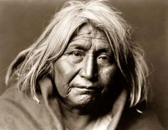 An exciting photograph of Apache De Gazza. It was made in 1903 by Edward S. Curtis.  It is a Head-and-shoulders portrait of an Old Indian Man. The man has a tired and sad look in his eye, doubtess the result of him seeing his traditional way of life disappearing with the coming of the new century.