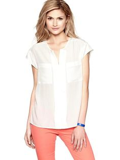 Love this shirt! Would be great with a breezy bright maxi skirt!