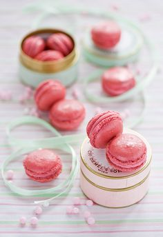 Pink macarons as wedding favours. Find more wedding favour ideas here http://raspberrywedding.com/category/raspberry-wedding/decoration/stationeryandfavours/