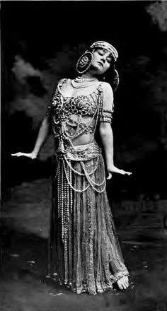 "1908 Vintage Theatre - Miss Lotta Faust in the Salome Dance in ""The Mimic World"".  Lotta Faust (February 8, 1880 – January 25, 1910) was an American actress, dancer, and singer from Brooklyn, New York. She performed an interpretation of the Salome dance based on the Salome (play) (1893) by Oscar Wilde"