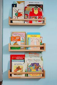 Kid bookshelves from Ikea spice racks $2.50 each!