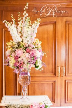 stunning fresh flowers arranged on a vintage chest of drawers for the ceremony at @Matt Valk Chuah Fairmont Royal York hotel.  @Patricia Smith Smith Smith Smith Price-Fullard Photography