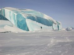 Frozen Tsunami Waves in Antarctica Caused by Earthquakes