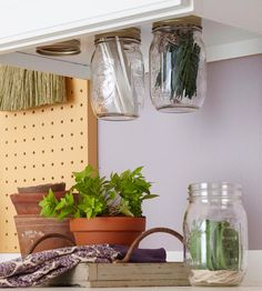 Use canning jars to hold supplies under a cabinet or shelf canning jars, kitchen storage, herb, storage jars, spice storage, cabinet storage, mason jars, storage ideas, jar lids