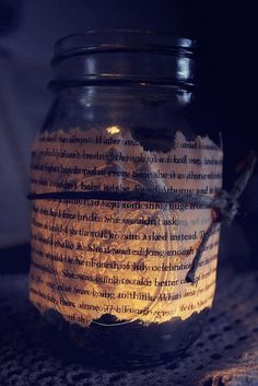 Mason jar + old book pages + raffia - could put some gingham on top so you can't see inside and use the fake flickering tea lights instead of candles?