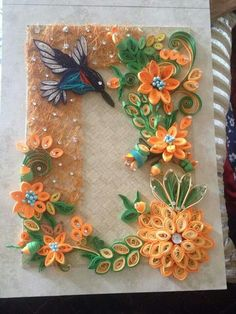 Quilled Hummingbird among lots of flowers - pinned by Dawn Kerley