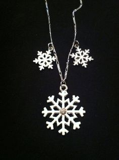 """Snow flake necklace On 16"""" silver coloured chain $16"""
