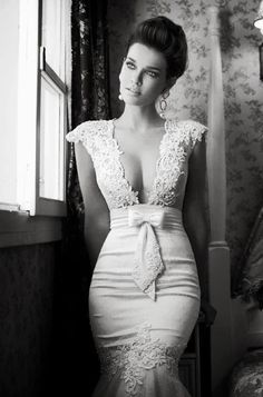 Laced shoulders wedding dress with torso bow. The lace is intricately balanced throughout. I'm not over the moon about the width of the lace on the shoulders, but I wouldn't dare to tell you that, my love. Your piercing philosophical stare has rendered me speechless; my towering physique frozen in wondrous awe.