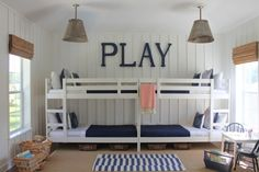 Two Ikea bunk beds painted white and and placed end-to-end.....great for the Grankids at Camp Babcock