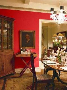 A standout red delivers zest to this otherwise traditional dining area. | Vibrant Red (4-12), @Pratt & Lambert Paints