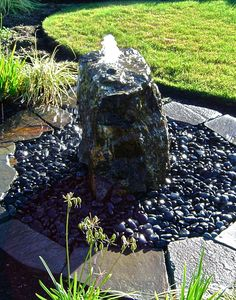 small fountain over rocks