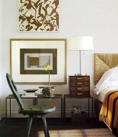 flawless composition of three end tables side by side below the painting with three similar geometric shapes