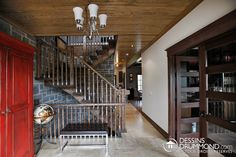 Rustic & industrial modern decor ! Stunning stair case for large house ideas. #Wood #Rustic DIY interior home decor with red furniture, beautiful light, wooden ceiling, french doors, white walls & modern accessories. Beautiful industrial style stair case at the foyer. Tile flooring.