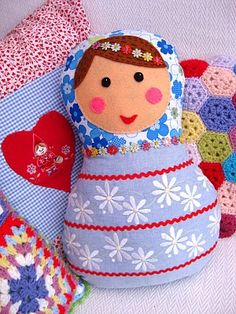 Russian Doll cushion (or doll, depending on size). I see it with patchwork stripes of multi-coloured and patterned fabrics. Could really go to town on this...and safe toy for a toddler