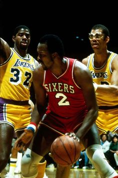 Malone is guarded by Kareem Abdul-Jabbar and Magic Johnson during the 1983 NBA Finals