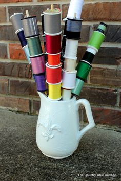 Put styrofoam in the bottom of the pitcher and use SMALL dowels...VERY nifty !!!