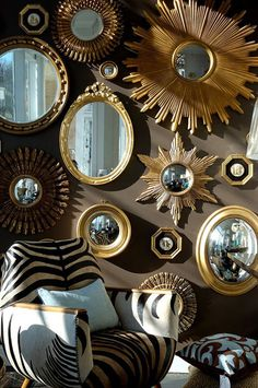 Small mirrors arranged all over a wall.