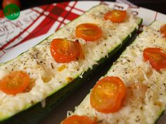 t cut a zucchini in half lengthwise and trim a little off the bottom so it sit still in a baking dish Scoop out the center where the seeds a...