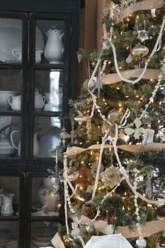 Beautiful tree (plus I love the cabinet hiding in the back)(from Jeanne Oliver)