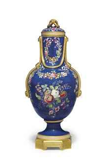 AN ORMOLU-MOUNTED SEVRES PORCELAIN BLEU FALLOT VASE AND COVER (VASE 'FLACON A CORDES')  CIRCA 1768, PROBABLY PAINTED BY MICAUD, THE ORMOLU MOUNT OF LATER DATE  The slightly domed cover with entwined ring finial, the neck and shoulder looped with gilt cords, incrusté with richly colored fruit and flowers within the bleu fallot ground, gilt with oeil-de-perdrix, the canted square base with bracket feet  15 5/8 in. (39.7 cm.) high (2)