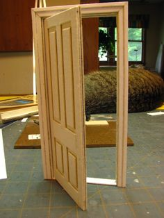 How to make a 1 inch scale dollhouse interior door and jamb from mat board.