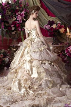 Strapless wedding gown in pale gold with butterfly accents from Stella de Libero.