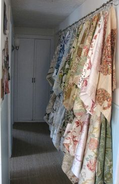 fabric samples are grommeted and hooked on curtain rods/ Lauren Liess Interiors