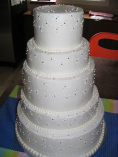 First wedding cake...chocolate fudge with chocolate filling layers and vanilla with bavarian cream filling layers. Picture taken before transportation...where top layer tumbled off! Cake was reconstructed and propped-up...and autumn leaves placed on top.