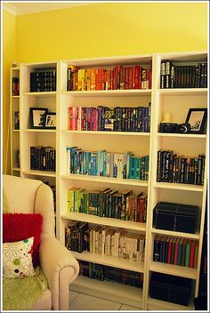 Books organized by color.