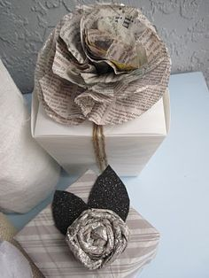 fun newspaper flowers for topping gifts