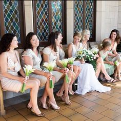 Bridesmaids wearing champagne-colored dresses in styles they chose themselves. Gina Leigh Photography.