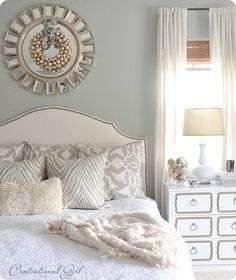 grey and cream bedroom... that mirror is gorgeous