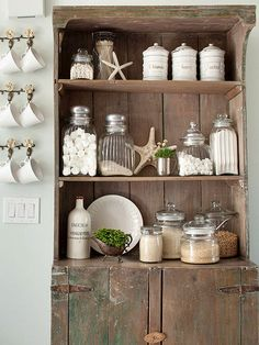 tuck natural finds into place that normally function as...functional. this hutch storing baking essentials gets a style boost from the starfish and plants
