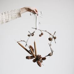 sweet gum branches + cattails + pinecones + ribbon