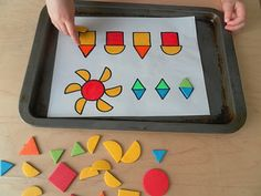 Make your own shape matching pages! magnetic shapes on a metal baking pan