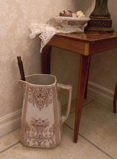 pitcher as toilet brush holder - genius!