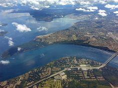Point Defiance Park peninsula and the narrows bridge (bottom right). Awesome photo! Tacoma, WA.