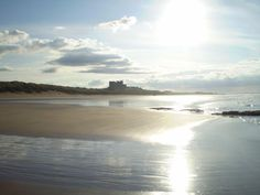 Sun setting at Bamburgh Beach