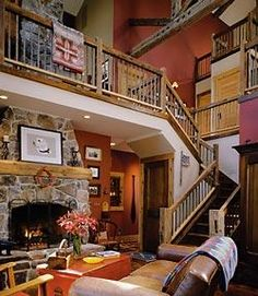 Entering Robin Layton's house, you ascend stairs that wind up and then open to this three-storied space. The second floor, a series of platforms, exudes a loft-like feel but is dressed in barn-salvaged wood and early-20th-century tobacco sticks as staircase balusters.-texture combos