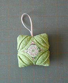 folded fabric ornament - cathedral window