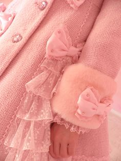 Pink coat with bows for little girls.