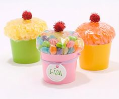 Great party favors that look like cupcakes! Fill a sandwich baggie with jelly beans and tie it tightly. Place baggie, closure side down, in a paper cup cut in half, then glue a red pom-pom to the top.