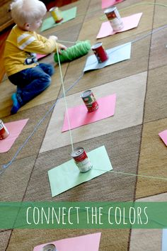 Connect the colors of paper with yarn in the same color - use canned food to wrap it around